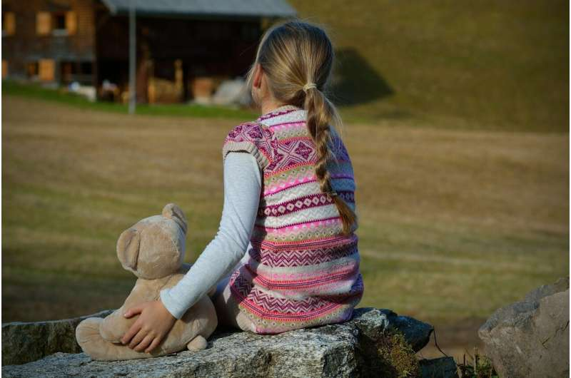 child with stuffed animal