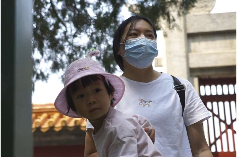 China faces strains as population ages, birth rate falls