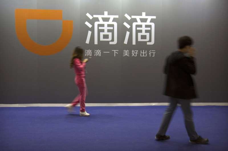 China's Didi ride-hailing service jumps in Wall Street debut