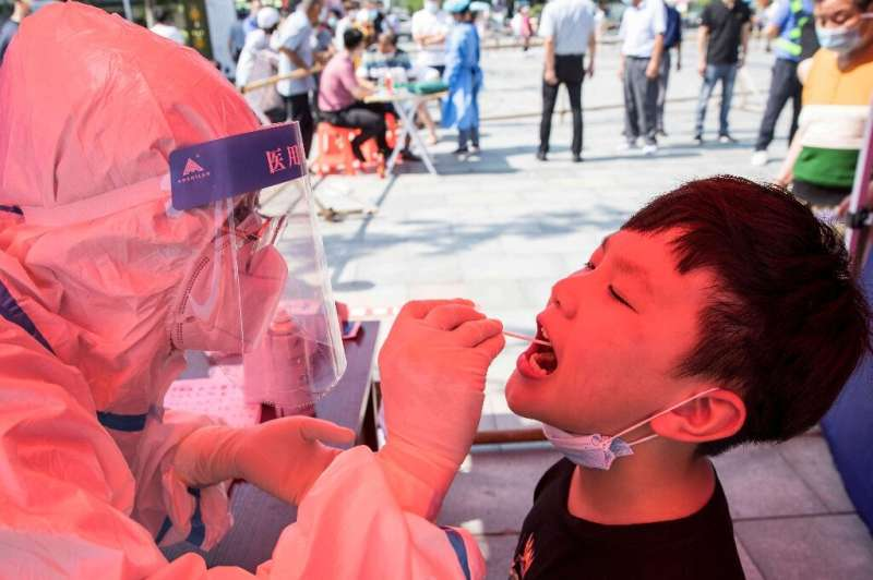 China's worst surge of coronavirus infections in months spread to two more areas
