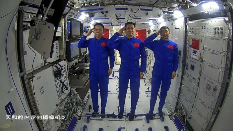 Chinese astronauts Tang Hongbo (L), Nie Haisheng (C) and Liu Boming (R) are the first crew on the nation's new space station