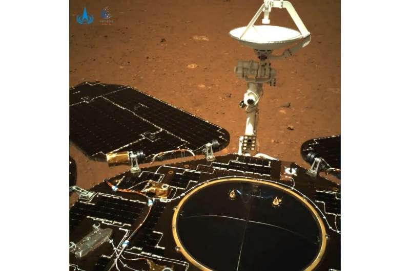 Chinese Mars rover beams back first photos