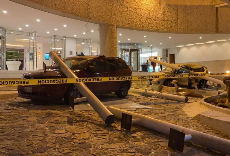 Damaged cars are seen outside a hotel in the Mexican resort city of Acapulco after a 7.1-magnitude earthquake