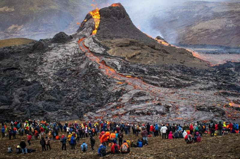 Daredevil spectators  have grilled sausages, bacon and marshmallows on the hot lava as it cools to basalt rock