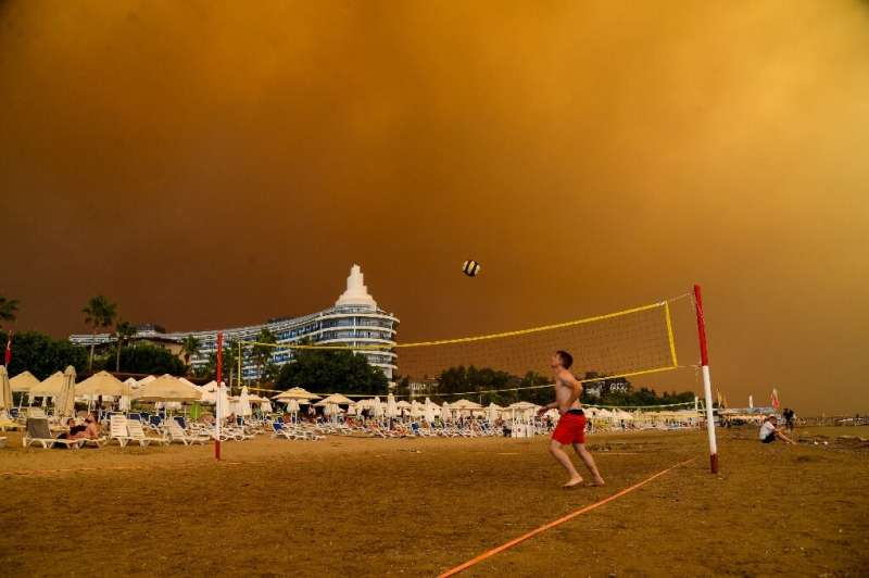 Dark smoke drifts over a hotel complex during a massive forest fire which engulfed a Mediterranean resort region on Turkey's sou