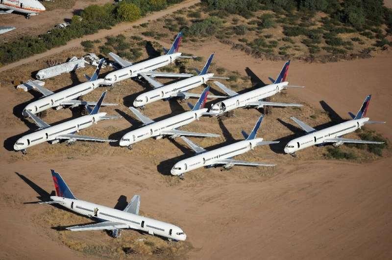 Delta Air Lines melaporkan kerugian besar untuk tahun 2020 karena virus korona, tetapi mengharapkan pasar yang membaik pada tahun 2021