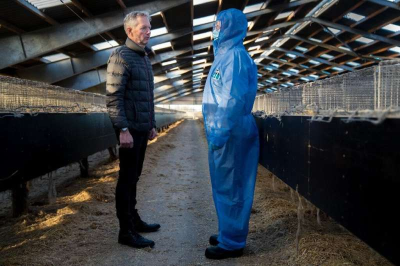 Denmark's Prime Minister Mette Frederiksen and mink breeder Peter Hindbo visit a closed and empty farm near Kolding, Denmark on