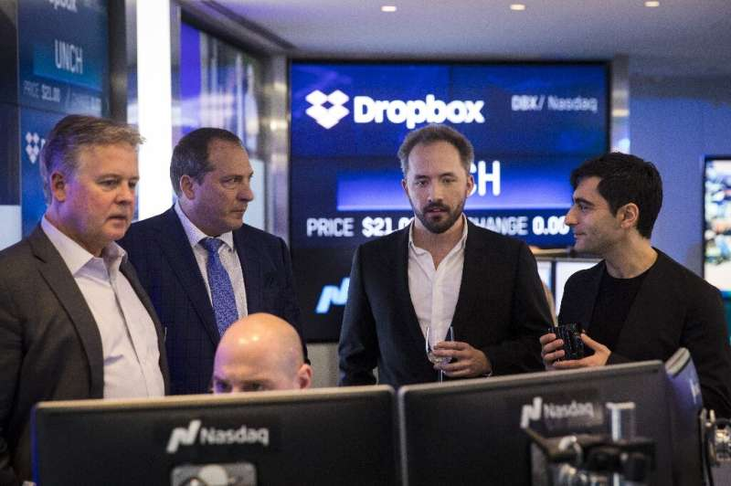Dropbox CEO Drew Houston (2nd from R) and Dropbox co-founder Arash Ferdowsi are seen at Dropbox's initial public offering at Nas