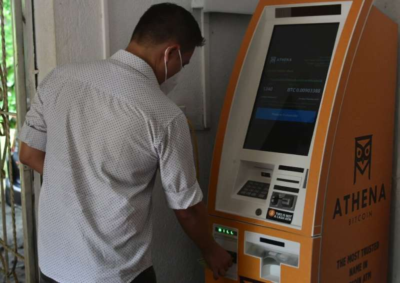 El Zonte boasts a bitcoin teller machine, the country's only one, where people deposit cash US dollars—El Salvador's official cu