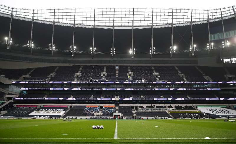 Empty seats are pictured in the empty stands ahead of the English Premier League football match between Tottenham Hotspur and Bu