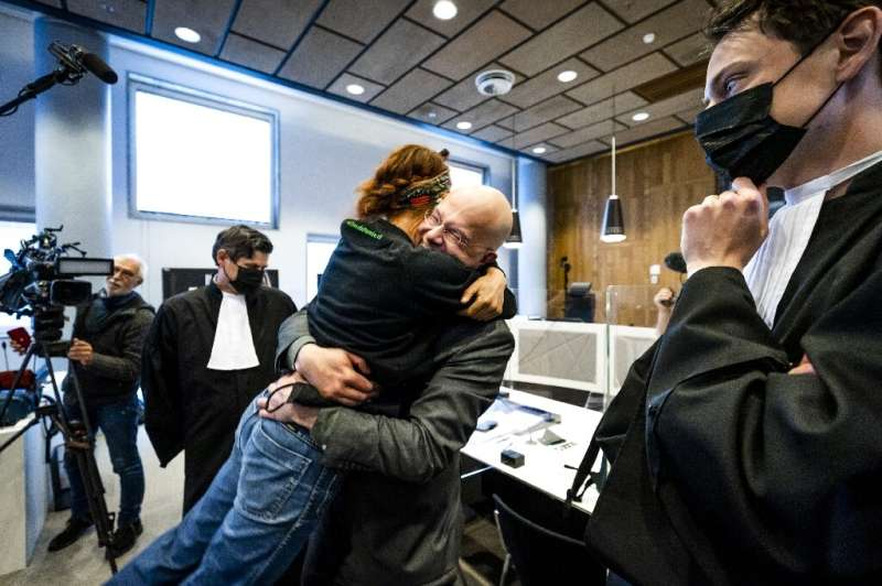 Environmentalists celebrate after The Hague court announced the landmark ruling