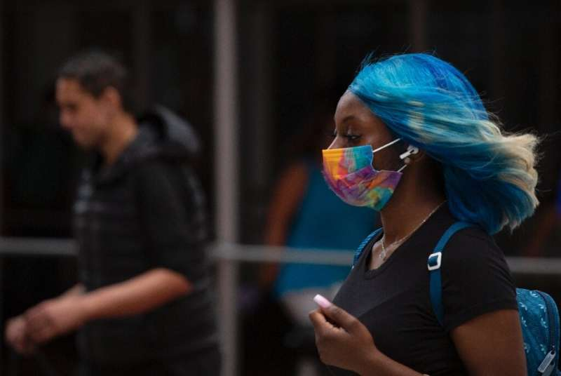 Face masks are reappearing in cities around the world as the Delta variant fuels a surge in coronavirus cases