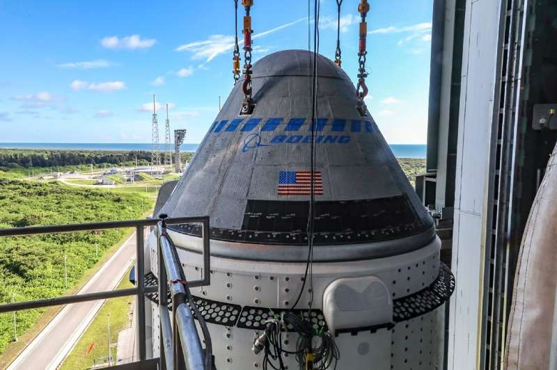 (FILES) This file photo obtained from NASA on July 28, 2021 shows the Boeing CST-100 Starliner spacecraft secured atop a United