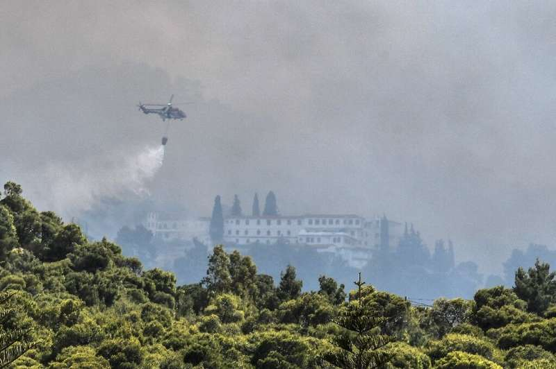 Firefighters used helicopters to tackle the blaze threatening villages and monasteries