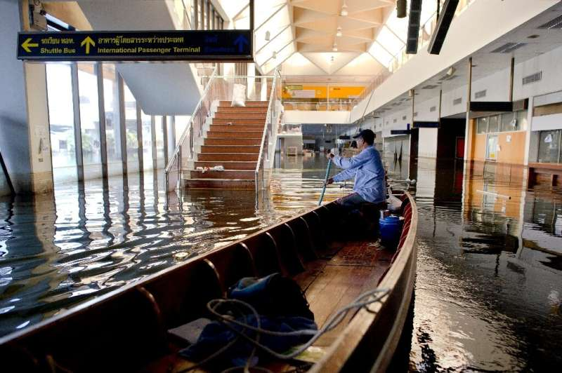 Flooding can threaten key infrastructure like this airport in Bangkok, deluged during huge 2011 floods