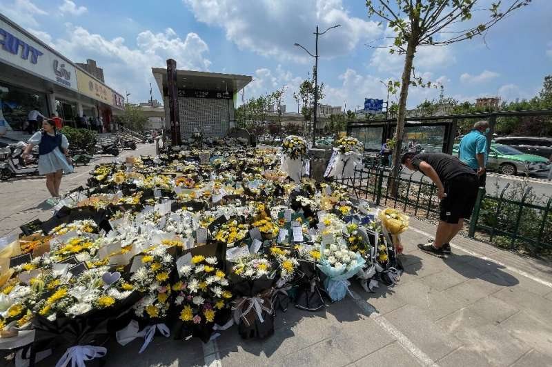 Flowers were laid in front of a subway station in in Zhengzhou, China in memory of flood victims