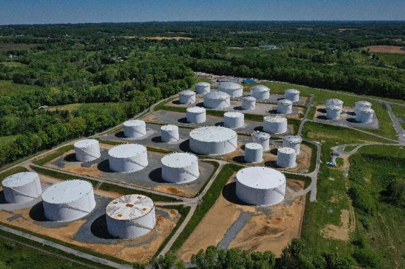 Fuel holding tanks are seen at Colonial Pipeline's Dorsey Junction Station in Woodbine, Maryland on May 13, 2021