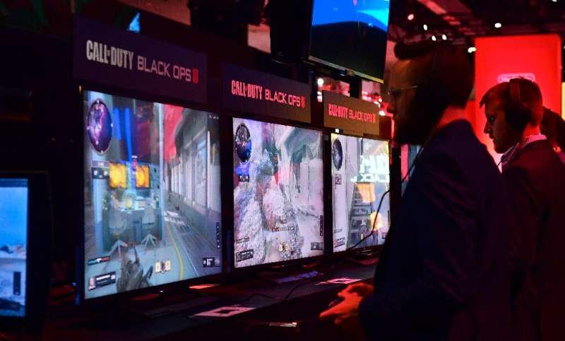 Gamers play the game Call of Duty: Black Ops at the 24th Electronic Expo, or E3 in Los Angeles, California on June 12, 2018
