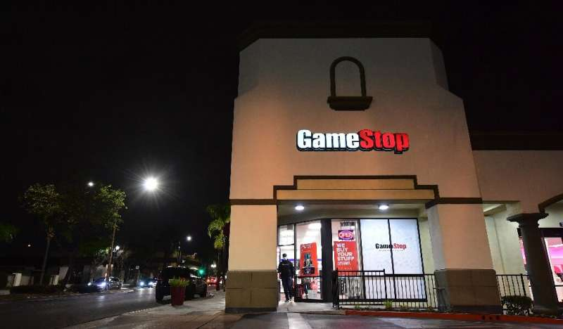 GameStop shares have soared in a clash between a new activist movement and hedge funds