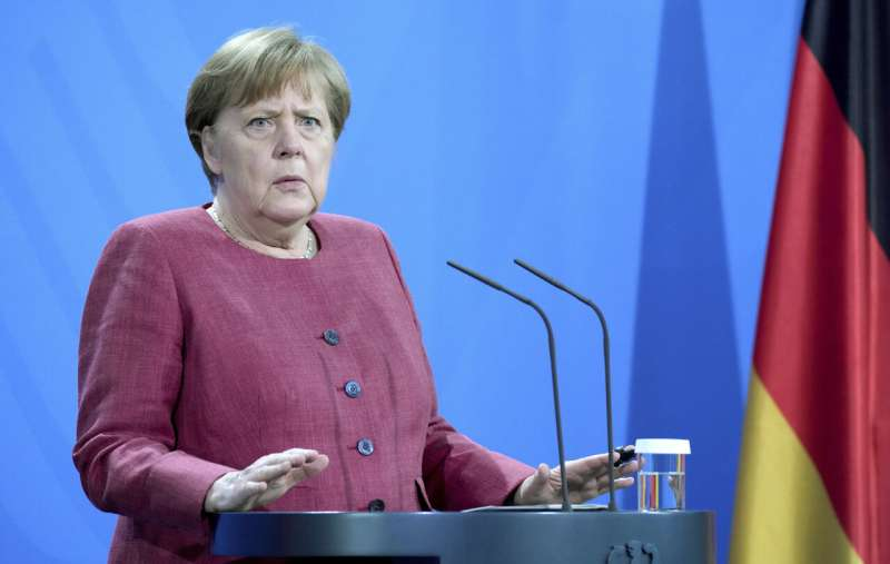Germany lifts more restrictions, Merkel urges caution