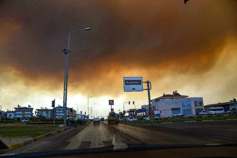 Heavy clouds of smoke rise from a massive forest fire which  engulfed a Mediterranean resort region on Turkey's southern coast n