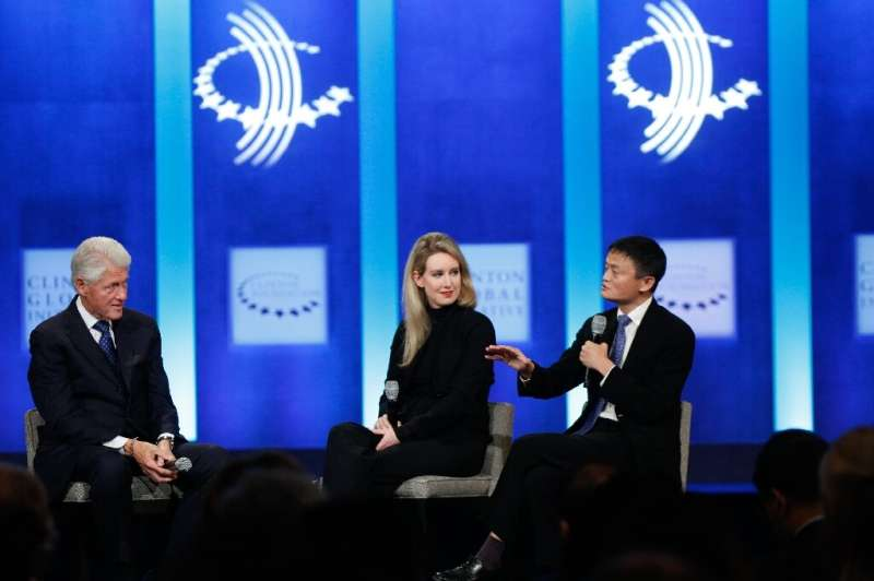 Holmes, seen here with Chinese entreprenur Jack Ma and former US president Bill Clinton was an object of fascination way beyond