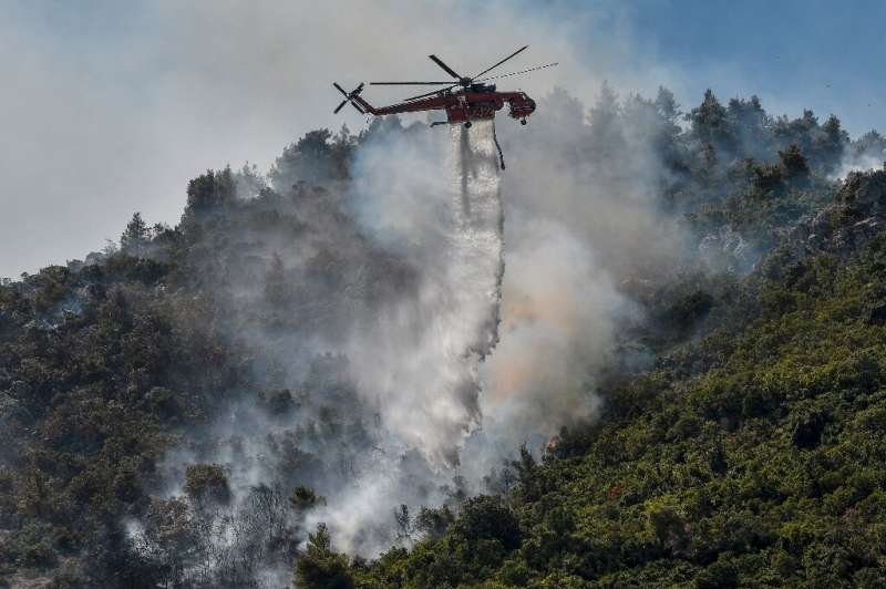 Hundreds of firefighters along with water-dropping aircraft are battling the blazes