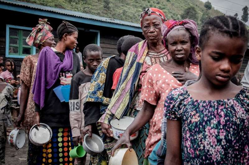 Hungry: Displaced people queue for food in Sake, 25 kms from Goma