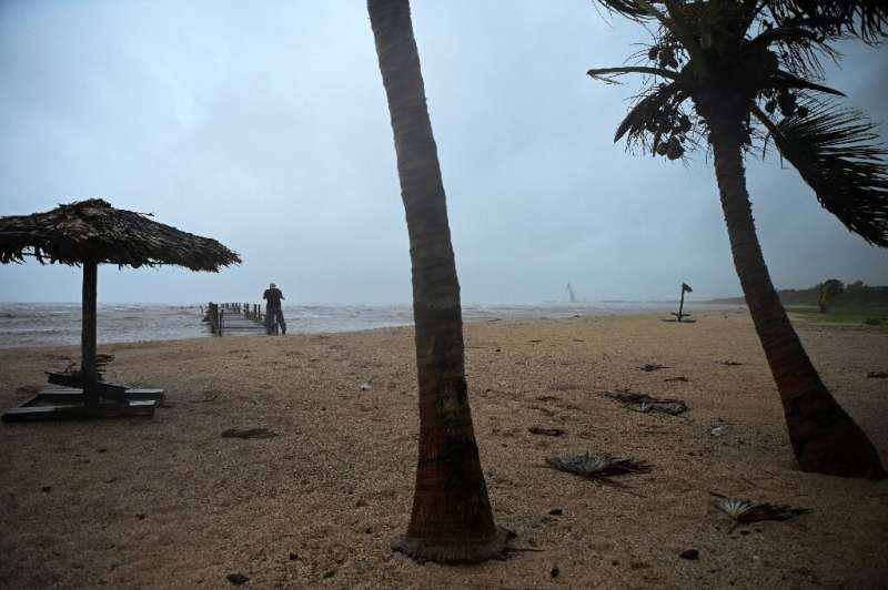 Hurricane Ida passed through western Cuba on Friday, forcing thousands to evacuate their homes