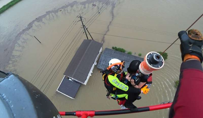 Images from Saga prefecture showed aviation rescue teams winching people to safety