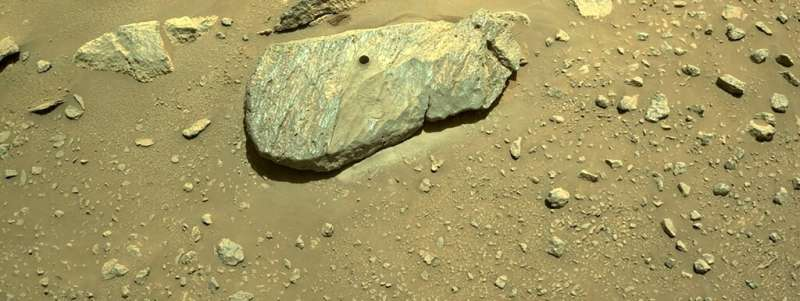 In this image released by NASA, the drill hole from Perseverance's second sample-collection attempt can be seen in a rock, in th