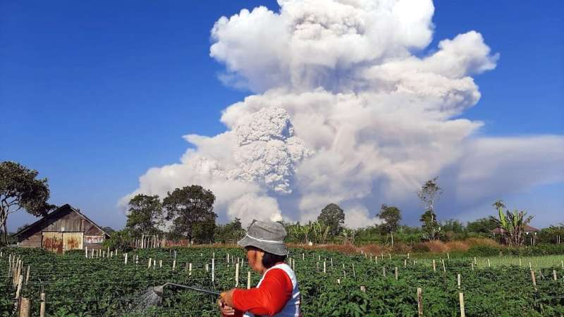 Indonesia's Mount Sinabung erupted on Tuesday morning, spewing out a massive column of smoke and ash