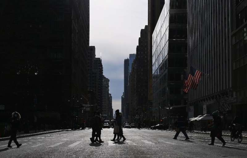 In the pre-Covid-19 era the streets of midtown Manhattan would be teeming with people - but now New York's famous business distr