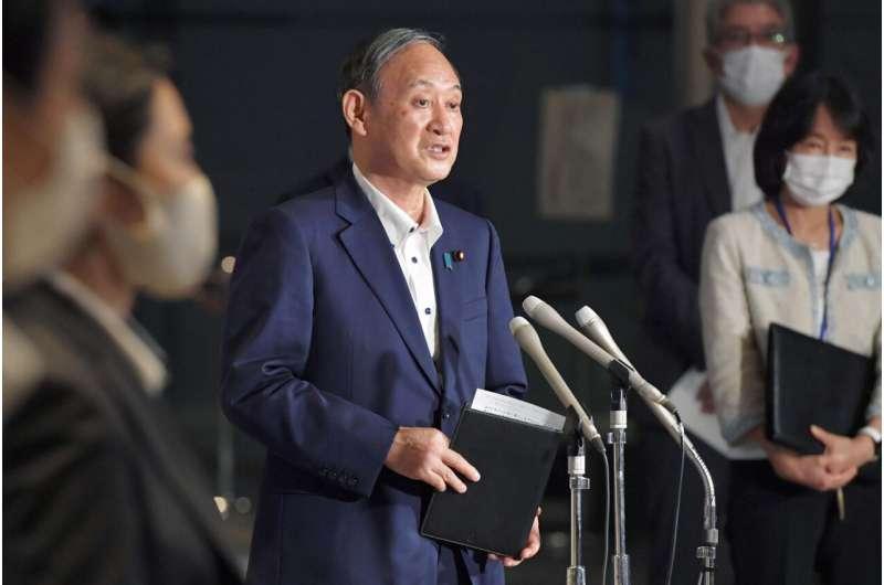Japan extends, expands coronavirus emergency as cases surge
