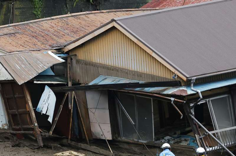 Japan searches for dozens missing in resort town mudslide