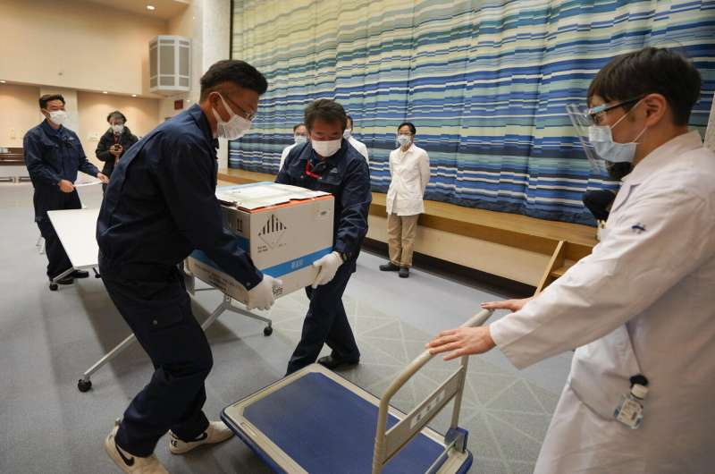 Japan begins COVID-19 vaccination drive amid supply worry