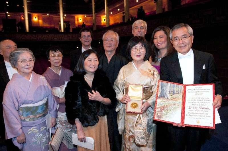 Japanese chemist Ei-ichi Negishi (R, with his family) won the Nobel Prize for his work developing a method to create complex che