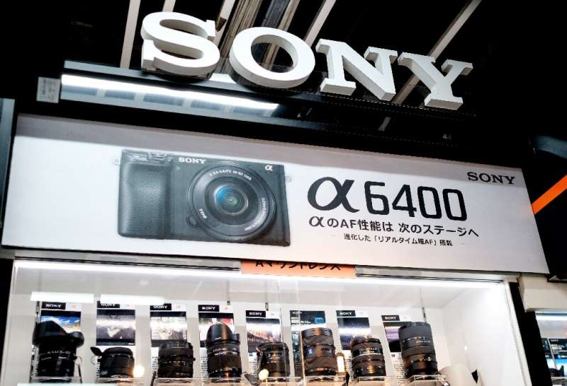 Japanese giant Sony issued a more cautious forecast for the year ahead