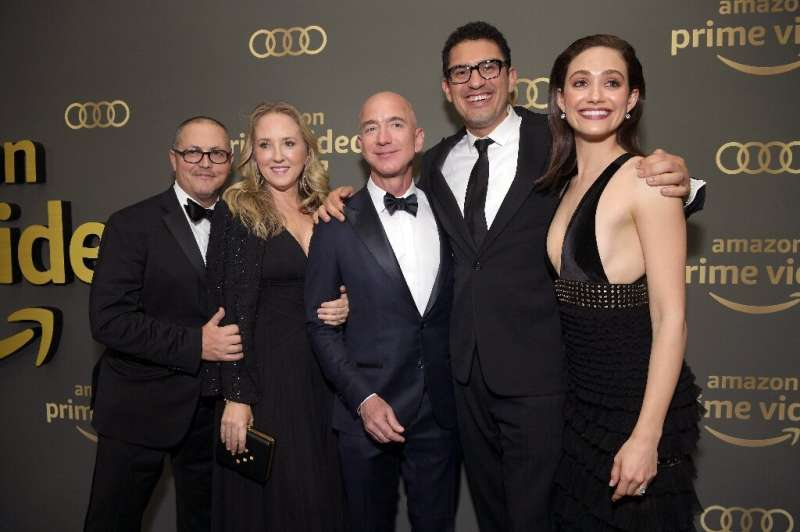 Jeff Bezos (center) is seen at  the Amazon Prime Video's Golden Globe Awards After Party in 2019 highlighting the success of Ama