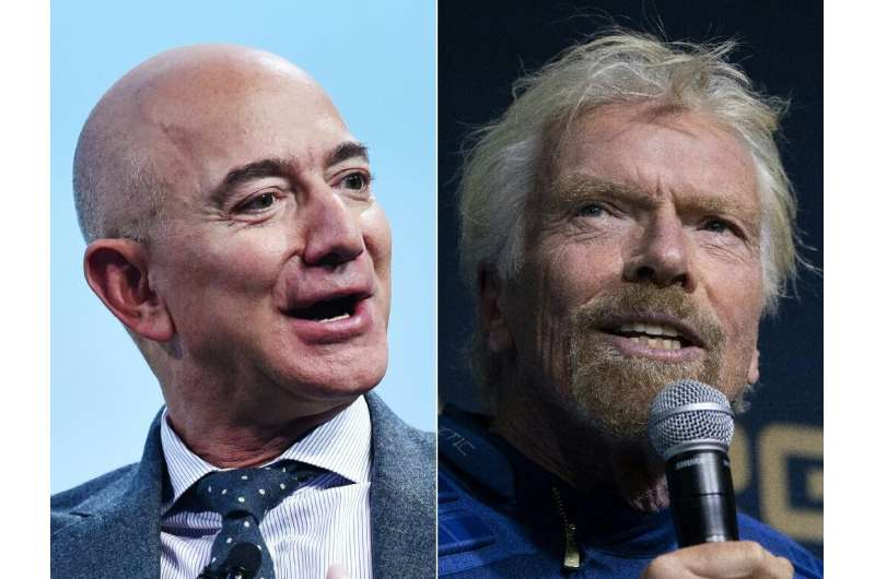 Jeff Bezos (L) and Richard Branson (R)launched Blue Origin and  Virgin Galactic in the early 2000s, and now both men stand on th