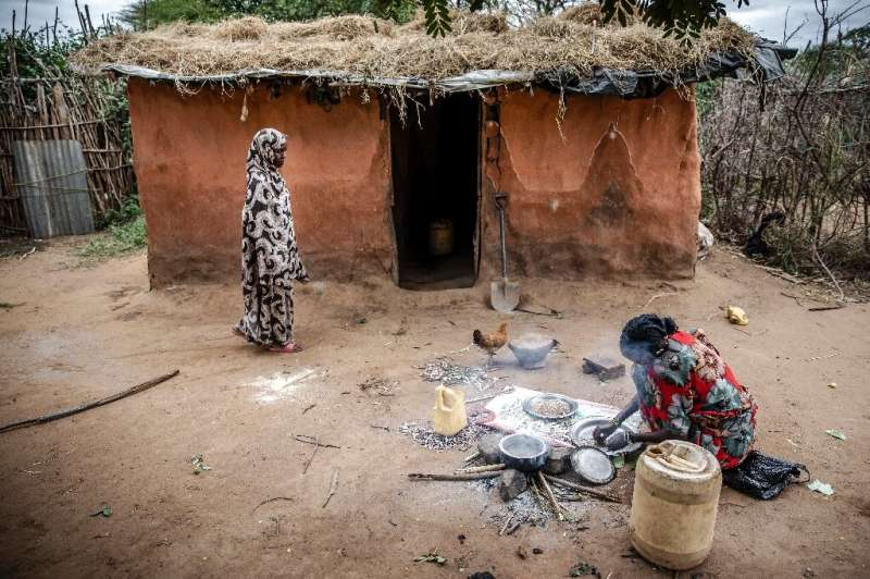Kenyan farmer Amina Guyo, shown cooking a cowpea stew, depends on agro-pastoralism and the sale of khat to support her household