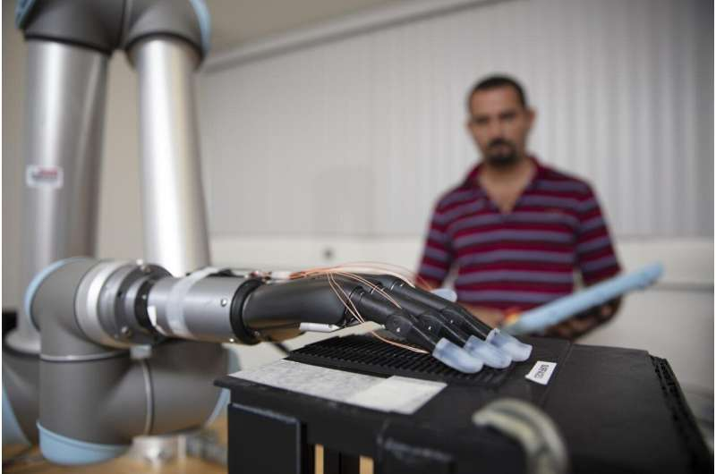Liquid metal sensors and AI could help prosthetic hands to 'feel'
