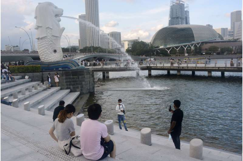 Living with COVID; Singapore strategy raises concerns, hope