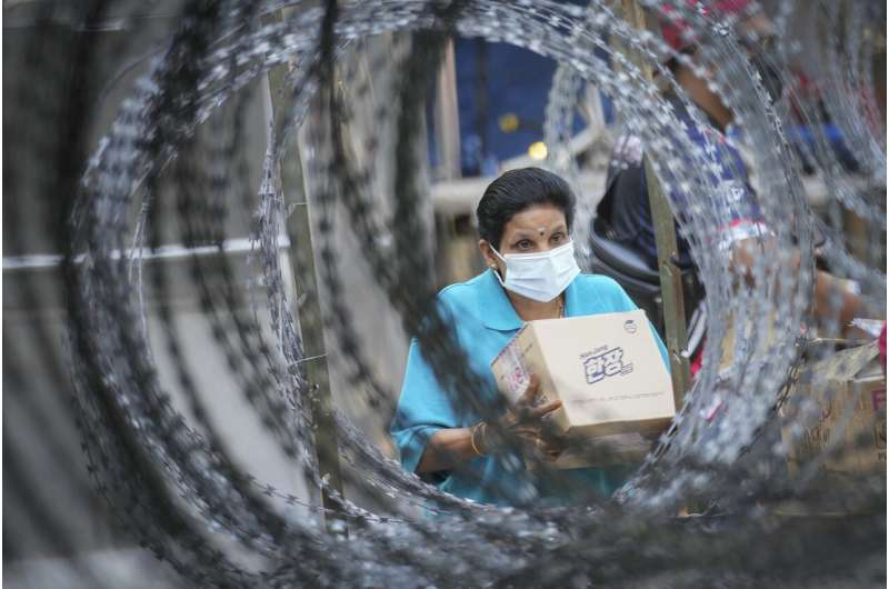 Malaysia imposes near-total lockdown after virus cases soar