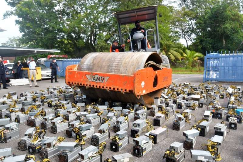 Malaysian police in Borneo destroy seized bitcoin-mining machines