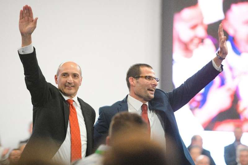 Malta Health Minister Chris Fearne, pictured on the left with Prime Minister Robert Abela in January. Malta has given at least o
