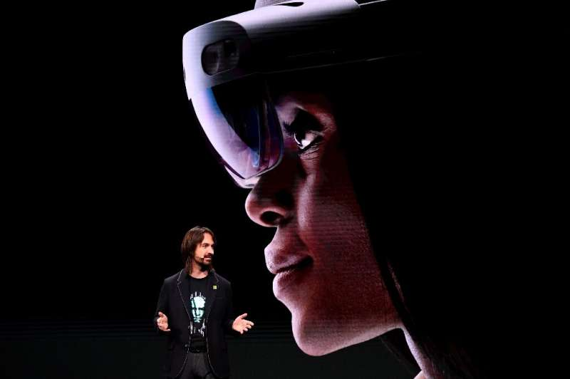 """Microsoft's technical fellow Alex Kipman speaks about """"HoloLens 2"""" during a presentation at the 2019 Mobile World Cong"""