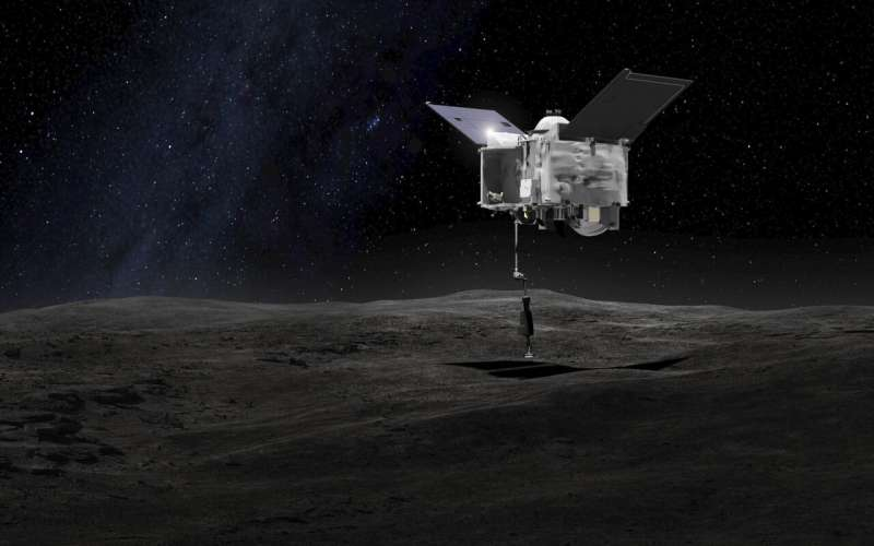 NASA spacecraft begins 2-year trip home with asteroid rubble