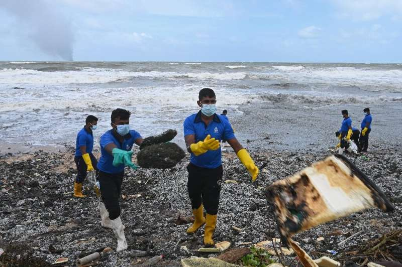 Navy personnel helped remove debris that washed ashore