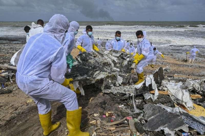 Navy sailors in hazmat suits were sent to clean the beach